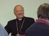 Otec biskup je zřejmě ve společnosti svých jáhnů spokojený...